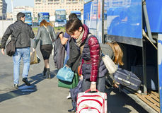 Passengers on bus station. APRIL 2014 - passengers arrived by bus to the Catania, Sicilia, Italy on 7 April 2014 Royalty Free Stock Photography