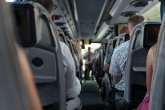 The passengers in the bus during the trip with tourists and guided tour. stock photo