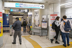 Passengers buying train ticket with ticket machine. Tokyo, Japan - NOV 18, 2016 :Passengers buying train ticket with ticket machine in the Tsukiji Station stock images