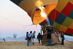 Passengers climbing into hot air balloon's basket Stock Photo