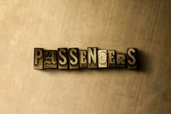 PASSENGERS - close-up of grungy vintage typeset word on metal backdrop Stock Images
