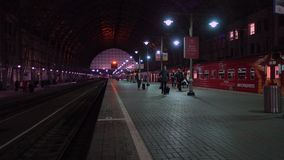 Passengers come to Kievskiy station by Aeroexpress train at night stock video