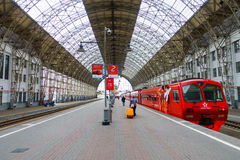 Passengers come to Kievskiy station by Aeroexpress train at night Stock Images