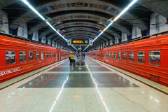 Passengers come to Kievskiy station by Aeroexpress train at night Royalty Free Stock Image