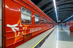 Passengers come to Kievskiy station by Aeroexpress train at night Royalty Free Stock Photo