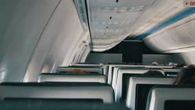 Passengers in comfortable seats of aircraft with maps on screens in chairs. Passengers in comfortable seats of aircraft with the screens in chairs stock video footage