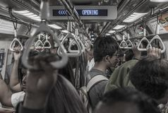 Passengers commute in the Singapore subway stock photography