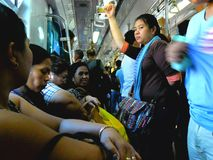 Passengers or commuters inside a train in manila, philippines in asia. Photo of passengers or commuters inside a train in manila, philippines in asia Stock Photo