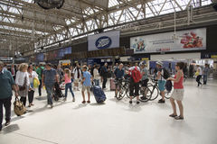 Passengers on concourse of railway station Royalty Free Stock Images