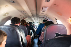 Passengers in Cramped Airplane Cabin Royalty Free Stock Photography