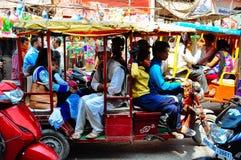 Busy traffic in Varanasi, India. Passengers cramped in a tuk tuk in a traffic jam Varanasi, India stock photography