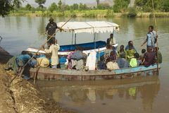 Passengers cross the Blue Nile river by local ferry boat to in Bahir Dar, Ethiopia. Royalty Free Stock Photography