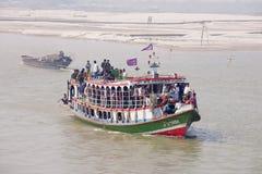 Passengers cross Padma river on Daulatdia ferry boat at Chhota Dhulandi, Bangladesh. CHHOTA DHULANDI, BANGLADESH - FEBRUARY 19, 2014: Unidentified passengers Stock Images