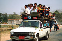 Passengers crowded. MANDALAY,MYANMAR-MARCH 19 : Local unidentified peoples in Myanmar rural areas commute dailyand dangerously in overloaded vehicles such as Royalty Free Stock Photo