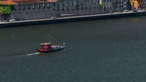 Passengers in a cruise on the Douro river in Tourist boat in Porto, Portugal timelapse stock video