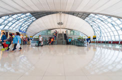 Passengers in departure area of Bangkok airport, Thailand Stock Images