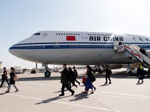 Passengers deplane airplane after landing in beijing china Royalty Free Stock Photo