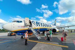 Passengers deplane Ryanair Jet airplane after landing in Pisa airport, Italy Royalty Free Stock Images