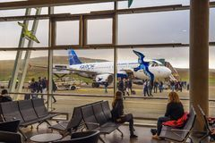Passengers disembark from airplane at the Faroe Islands airport