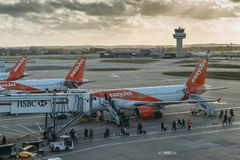 Passengers disembark from an Easyjet airplane at London`s Gatwick airport. London Gatwick, UK - Nov 23rd, 2017: Passengers disembark from an Easyjet airplane at Royalty Free Stock Photos