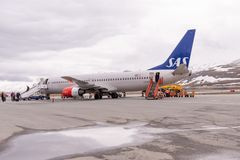 Passengers disembark from a SAS jet at the airport at Longyearbyen royalty free stock image