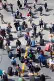 Passengers disembark from the ship at the port of Paros in Greec Royalty Free Stock Image