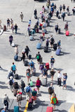 Passengers disembark from the ship at the port of Paros in Greec Royalty Free Stock Images