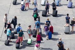Passengers disembark from the ship at the port of Paros in Greec. Paros, Greece, May 17, 2015: Passengers disembark from the ship at the port of Paros in Greece Royalty Free Stock Photography