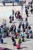 Passengers disembark from the ship at the port of Paros in Greec Stock Photo