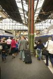 Passengers disembark the TGV. PARIS - OCT 3, 2011 - Passengers disembark the TGV high speed train at the Gare de Lyon railway station,  on Oct 3, 2011, in Paris Royalty Free Stock Image