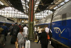 Passengers disembark the TGV. PARIS - OCT 3, 2011 - Passengers disembark the TGV high speed train at the Gare de Lyon railway station,  on Oct 3, 2011, in Paris Royalty Free Stock Photo