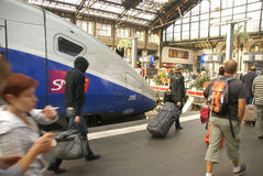 Passengers disembark the TGV. PARIS - OCT 3, 2011 - Passengers disembark the TGV high speed train at the Gare de Lyon railway station,  on Oct 3, 2011, in Paris Royalty Free Stock Photos