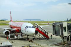 Passengers disembarking from AirAsia plane Stock Photography