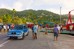 Passengers disembarking from an inter-island ferry in the caribbean Royalty Free Stock Image
