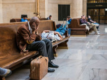 Passengers doze in Great Hall, Union Station, Chicago. Several men passengers sleep on benches as they wait for their trains in the Great Hall of Union Station Royalty Free Stock Image