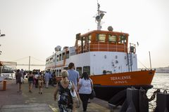 Passengers embark on ferry. People embarking on boat to Lisbon royalty free stock photo
