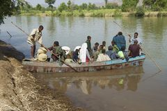 Passengers embark local ferry boat to cross the Blue Nile river in Bahir Dar, Ethiopia. Stock Images
