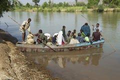 Passengers embark local ferry boat to cross the Blue Nile river in Bahir Dar, Ethiopia. BAHIR DAR, ETHIOPIA - JANUARY 21, 2010: Unidentified passengers embark stock images