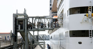 Passengers embarking on an ocean liner. Boarding gangway on a maritime station Stock Image