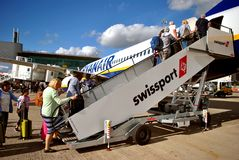 Passengers embarking on a Ryanair Airbus A320 aircraft. Manchester, England, UK, Europe - September 28, 2017 : Passengers sembarking on a Rayanair Airbus A320 stock image