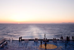 Passengers enjoy the sunset on a ferry. Travelling in the Mediterranean sea Royalty Free Stock Image
