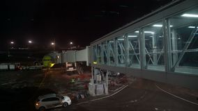 Passengers enter the aircraft by jet bridge