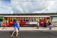 Passengers enter a streetcar in New Orleans Royalty Free Stock Photos