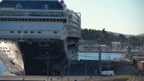People entering big cruise ship at port of Split stock video footage