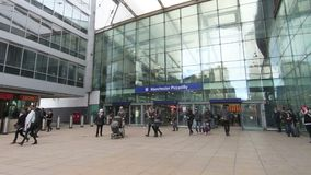 Passengers Entering and Leaving Manchester Piccadilly Statio. A slow motion recording of passengers entering and leaving Manchester Piccadilly Station in stock video footage