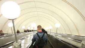 Passengers at escalator at Moscow metro station stock video footage