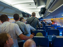 Passengers expect exit the aircraft after landing Royalty Free Stock Photo