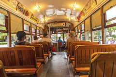 Passengers fill the seats of one of the historic green St. Charl Royalty Free Stock Image