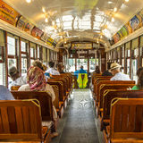 Passengers fill the seats of one of the historic green St. Charl Royalty Free Stock Photography