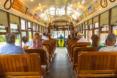 Passengers fill the seats of one of the historic green St. Charl Stock Photos